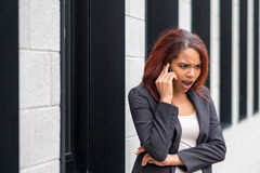 Businesswoman shocked while phoning on Mobile Phone Royalty Free Stock Photos
