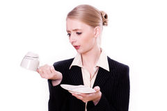 Businesswoman shocked by shortage of coffee Stock Photo