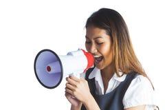 Businesswoman shooting through a megaphone Stock Photo