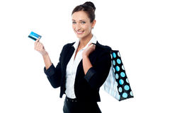 Businesswoman with shopping bag and cash card Stock Photography