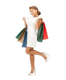 Businesswoman with shopping bags on high heels Stock Photos
