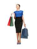 Businesswoman with shopping bags on high heels Royalty Free Stock Photos