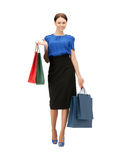 Businesswoman with shopping bags on high heels Stock Photo