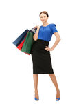 Businesswoman with shopping bags on high heels Royalty Free Stock Image