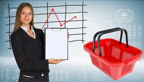 Businesswoman with shopping basket and graphs Royalty Free Stock Photography