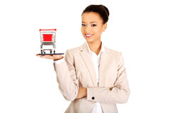 Businesswoman with shopping cart and tablet. Royalty Free Stock Photography