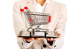 Businesswoman with shopping cart and tablet. Royalty Free Stock Image