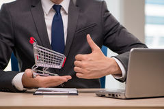 The businesswoman with shopping cart trolley Stock Photo