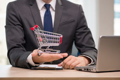 The businesswoman with shopping cart trolley Royalty Free Stock Photo