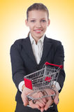 Businesswoman with shopping cart Stock Photography