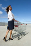 Businesswoman and shopping trolley Stock Images