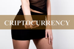 Businesswoman in short skirt pressing criptocurrency button of a touchscreen. exchange and production of crypto currency concept Royalty Free Stock Images
