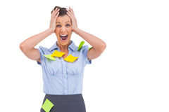 Businesswoman shouting with adhesive notes on her shirt Stock Images