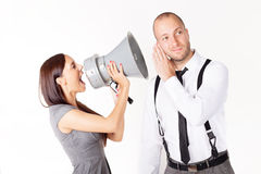 Businesswoman shouting at a businessman with megaphone Stock Photo