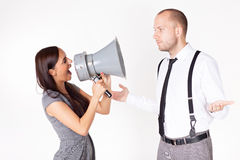 Businesswoman shouting at a businessman with megaphone Royalty Free Stock Photo