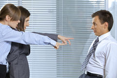 Businesswoman shouting at businessman in office Stock Image