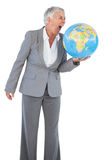 Businesswoman shouting at globe Stock Photo