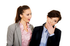 Businesswoman shouting on her tired partner. Stock Photo