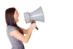 Businesswoman shouting on his megaphone Royalty Free Stock Photography