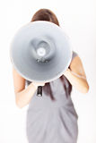 Businesswoman shouting on his megaphone Royalty Free Stock Image