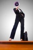 Businesswoman shouting through loudspeaker Stock Photography