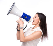 Businesswoman shouting in loudspeaker Stock Photography