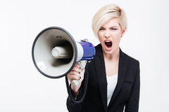 Businesswoman shouting into loudspeaker Stock Photography