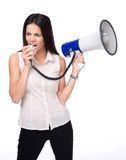 Businesswoman shouting in loudspeaker Royalty Free Stock Photos