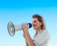 Businesswoman shouting through a megaphone Royalty Free Stock Images