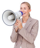 Businesswoman shouting through a megaphone Stock Images