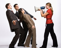 Businesswoman shouting with megaphone Stock Photo