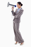 A businesswoman shouting through a megaphone Royalty Free Stock Photography