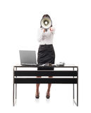 Businesswoman shouting with a megaphone Stock Photo