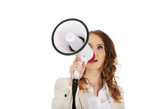 Businesswoman shouting with megaphone. Stock Photo