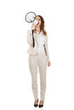 Businesswoman shouting with megaphone. Stock Images