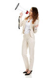 Businesswoman shouting with megaphone. Royalty Free Stock Photography