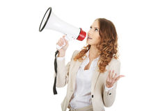 Businesswoman shouting with megaphone. Stock Image