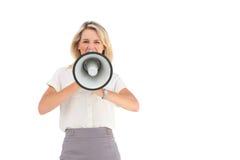 Businesswoman shouting through megaphone Royalty Free Stock Photography