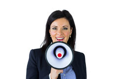 Businesswoman shouting through a megaphone Stock Image