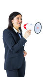 Businesswoman shouting through a megaphone Stock Photos