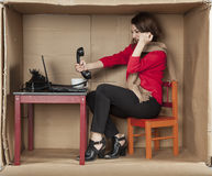 Businesswoman shouting into a phone, office situation Royalty Free Stock Photos