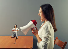 Businesswoman shouting at small calm woman Stock Photo