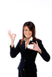 Businesswoman shoving a card with ok Royalty Free Stock Photo