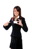 Businesswoman shoving a card pointing it Stock Images