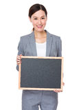 Businesswoman show with balckboard Royalty Free Stock Photography