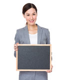 Businesswoman show with blank blackboard. Isolated on white background Royalty Free Stock Image