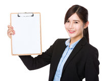 Businesswoman show with the blank page on clipboard Royalty Free Stock Images