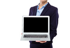 Businesswoman show with blank screen of laptop computer. Isolated on white Royalty Free Stock Photos