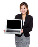 Businesswoman show with blank screen of laptop computer Stock Image