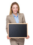 Businesswoman show with chalkboard. Isolated on white background Stock Photography